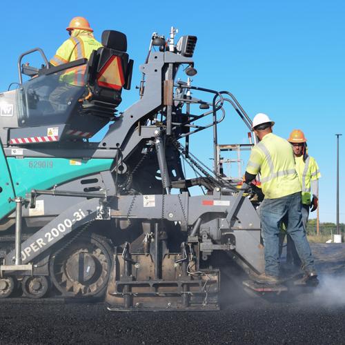 workers flattening asphalt